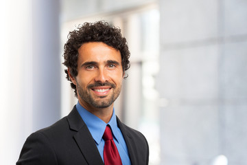 Smiling handsome businessman portrait