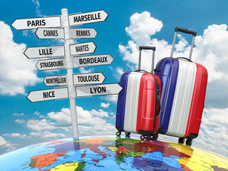 Travel concept. Suitcases and signpost what to visit in France