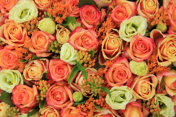 Orange and yellow roses in a bridal bouquet