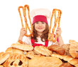 little girl cook with pastry pretzels and breads