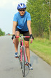 male cyclist riding a bike on an open road