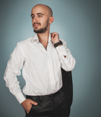 Elegance man in white shirt looking away