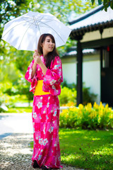 Beautiful young woman wearing japanese traditional Yukata