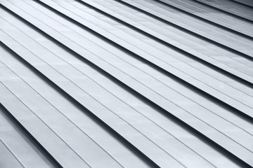Diagonal corrugated metal gray rooftop surface