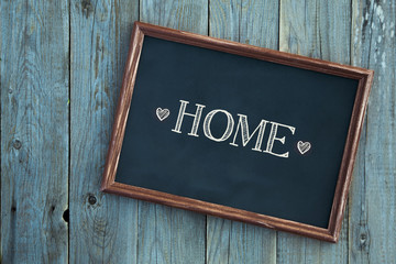 wooden vintage frame WELCOME HOME over wooden background