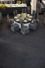 arranged round tables in the hall for weddings