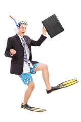 Businessman with diving equipment holding a bag