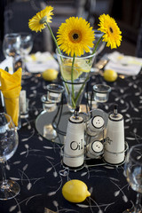 floral arrangement of small sunflowers in vase on the table