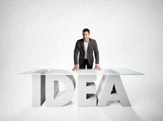 Portrait of a business man leaning on IDEA table