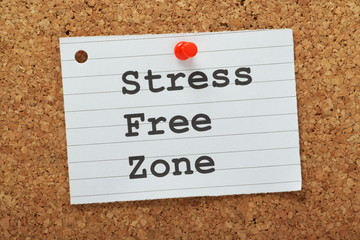 The phrase Stress Free Zone on a cork notice board