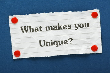 The question What Makes You Unique? on a blue notice board