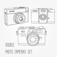 Set of three hand drawn photo cameras