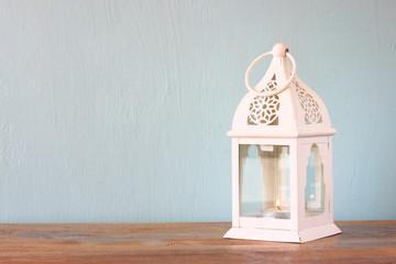 white lantern over wooden table