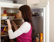 woman  near refrigerator  at home