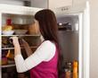 woman  near refrigerator  at home