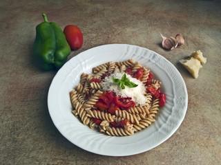 Italian cuisine - barley pasta, sweet pepper and tomato sauce