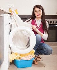 girl doing laundry with washing machine