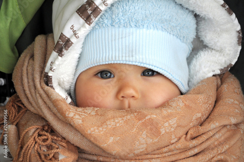 canvas print picture Baby in warm clothes in cold weather