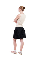 back view of standing young blonde woman.