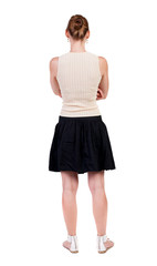 back view of standing young beautiful  woman.