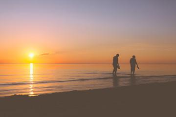 Senior couple strolling along the shore