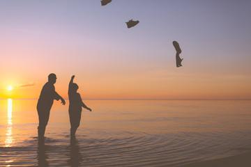 Senior couple throws shoes