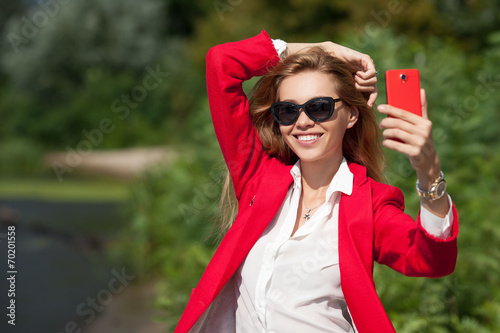 canvas print picture beautiful girl photographed themselves on the phone