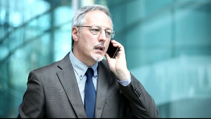 Portrait of a mature businessman talking at the phone
