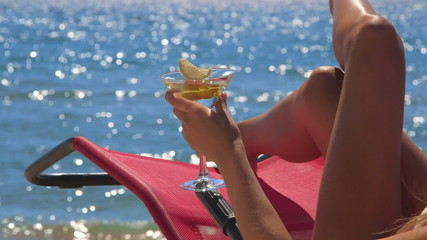 Girl with cocktail enjoying summer vacation