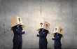 People with boxes on head
