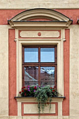 Classical colorful window with pediment in Prague