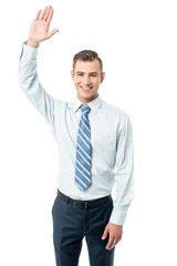 Business execuitve raising his hand