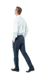Businessman walking forward, hands in pocket
