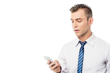 Businessman operating his mobile phone