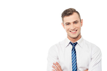 Smiling corporate man with folded arms