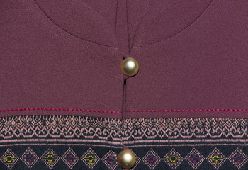 Generally Thai traditional silk shirt with gold button.