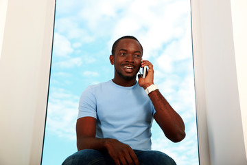 Portrait of a happy african man talking on the phone