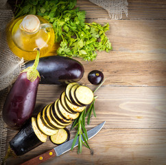 Eggplant and olive oil on a wooden board