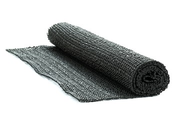 A roll of black non-slip rubber matting on a white background