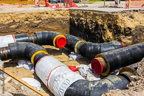 Newly laid pipe in a fresh trench. Unfinished pipeline