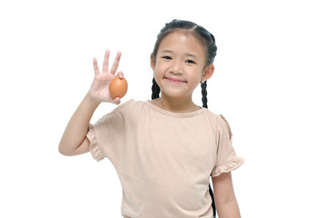 Asian girl smiiing and holding egg