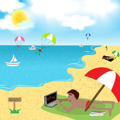 Man is playing laptop on the beach
