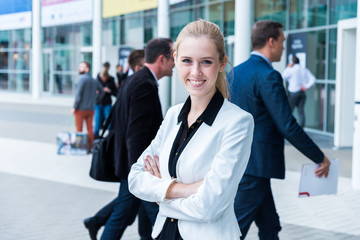 young business woman at a trade fair entrance