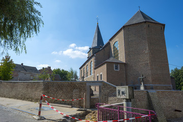 Ancient church under reconstruction in summer