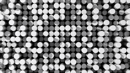Background of white reflective extruded cylinders or rods
