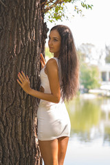 Beauty Girl in short dress on nature background.