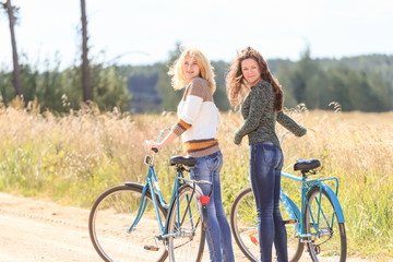 Two happy girls during cycling