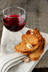 thin croutons pistachios and a glass of red wine