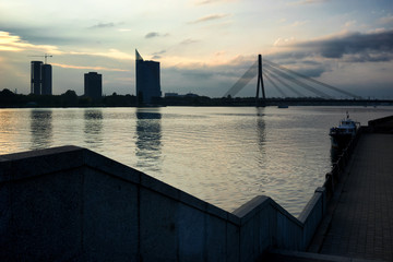 Daugava in Riga with tall buildings and cable-stayed bridge