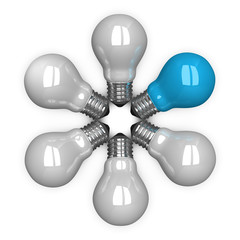 Blue tungsten light bulb among white ones lying radially